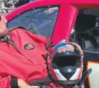 Image of JR next to race car